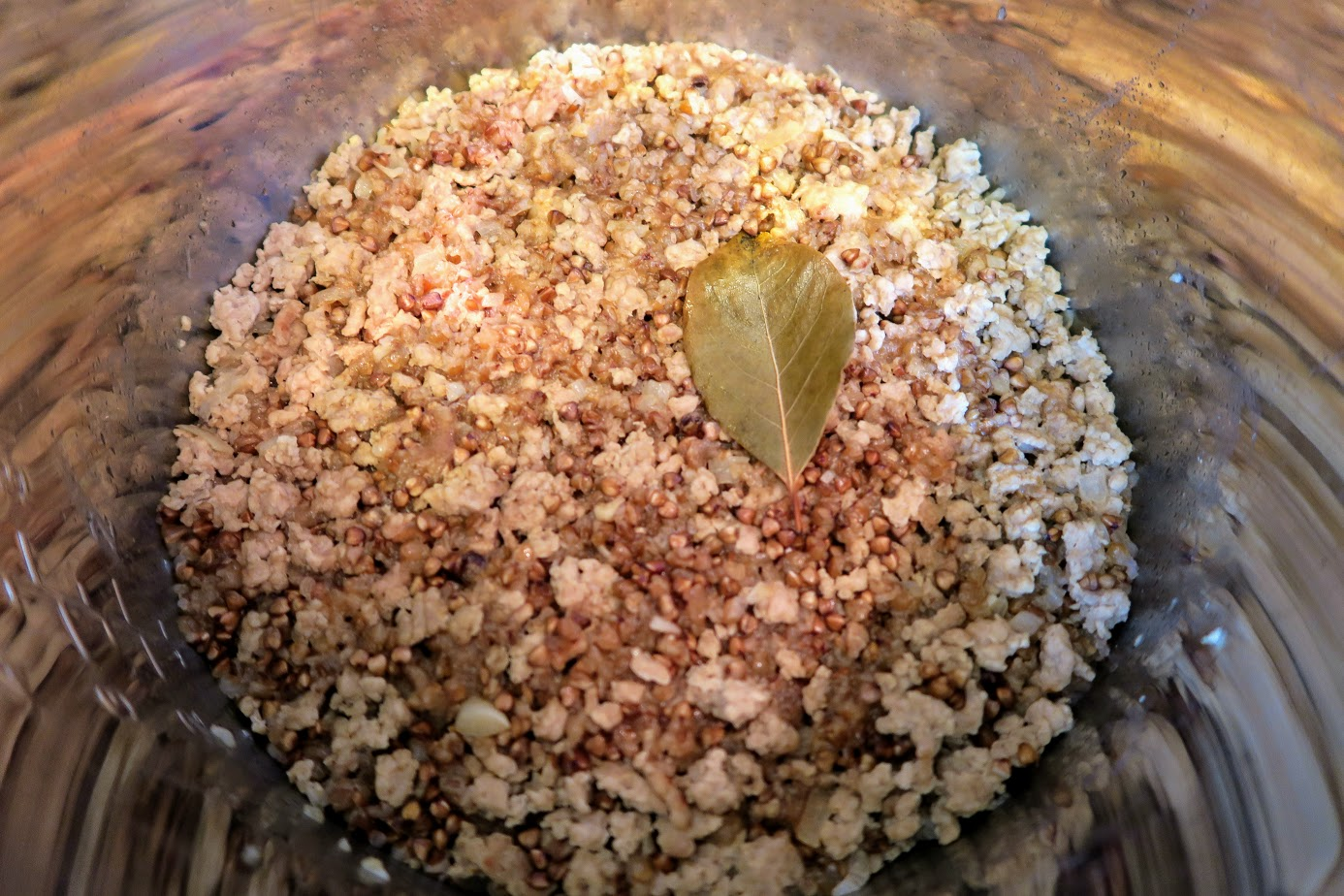 Cooked filling of buckwheat and meat (that rhymes!) inside the Instant Pot with the bay leaf on top