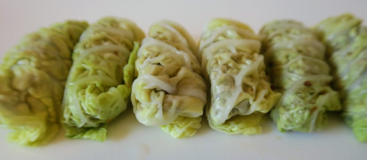 Six very neat uncooked little cabbage rolls