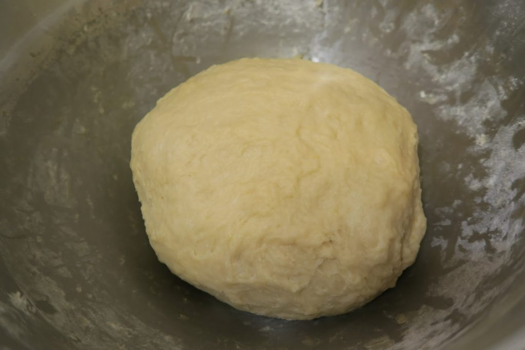 After kneading in the bowl, the ball of dough is smooth