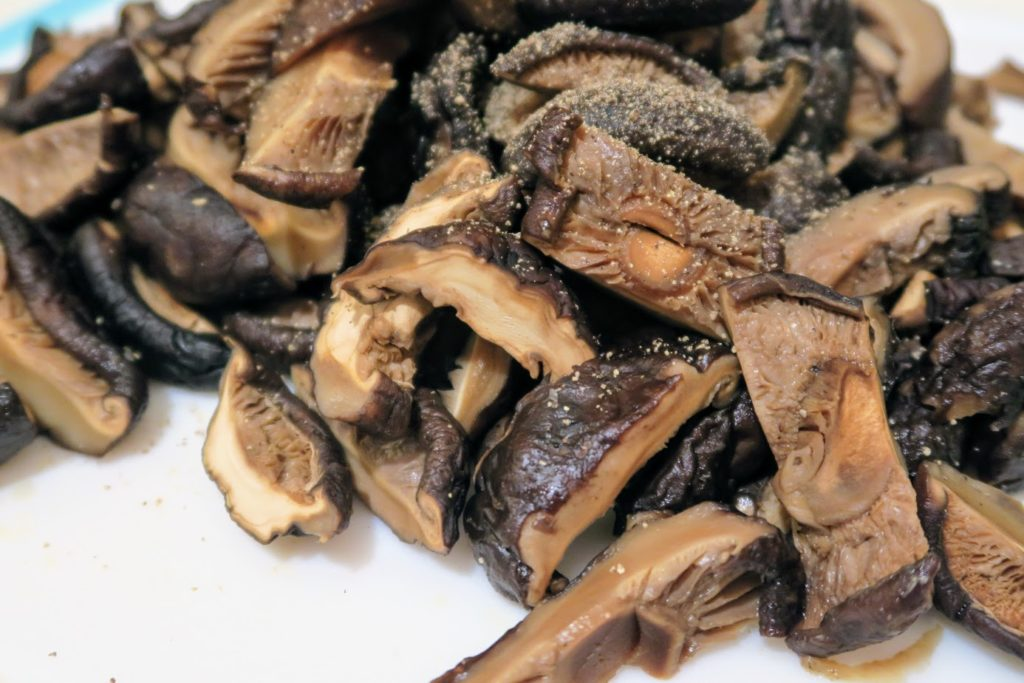 Sliced, hydrated mushrooms with stems removed