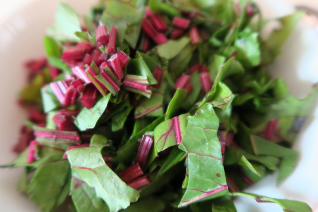 Finely chopped beet greens and stems