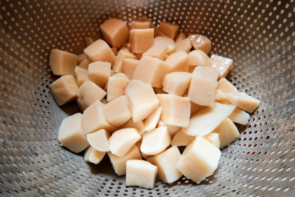 Canned potato cubes rinsed in a collander