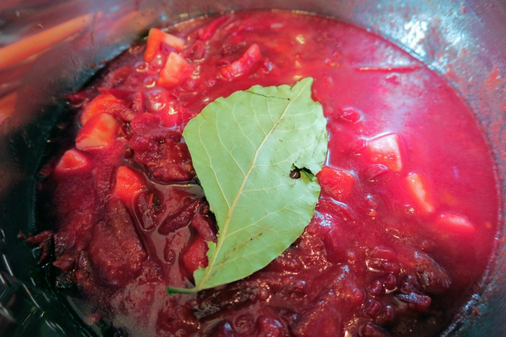 Pre-cooked borscht with an enormous bay leaf on top