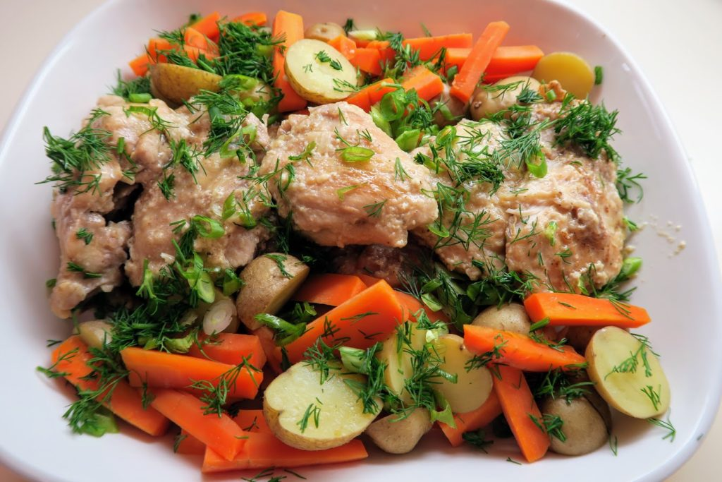 Top the chicken and vegetables with dill and green onions