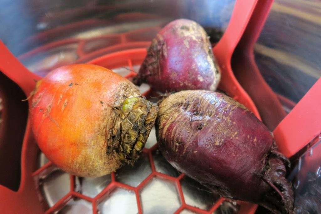 Three beets ready to steam in the Instant Pot