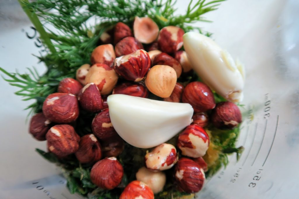 Roasted hazelnuts, garlic, herbs ready to blend