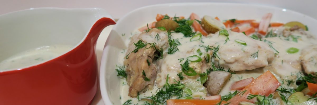 Chicken, potatoes and carrots covered in a cream sauce with dill and green onions