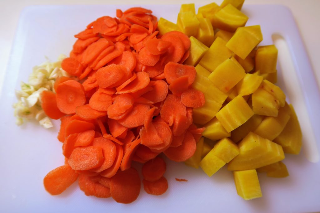 Chopped garlic, carrot coins and cubed golden beet