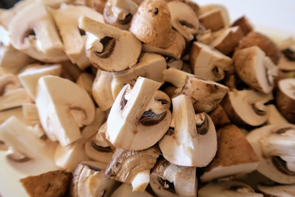 Button mushrooms chopped in quarters